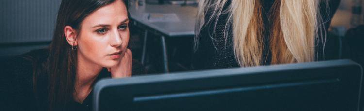 A woman reviews machine learning marketing data